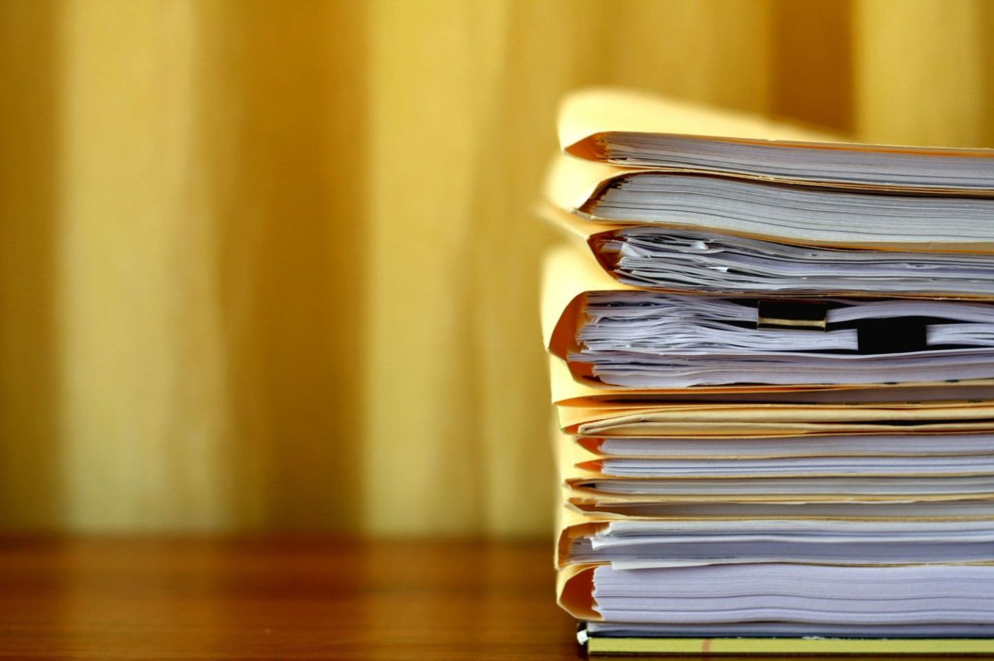 stack of folders containing papers